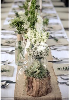 Rustic flower arrangement on timber for the opening on dining table?