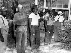African Americans in Milledgeville wait in line to vote following the Civil Rights Act of 1957. The act created both the Civil Rights Division of the Justice Department and a commission to investigate racial or religious discrimination during voter registrations and elections.