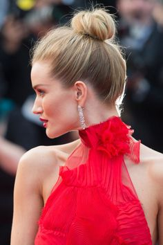 18 of the best unique bridal hairstyles: Sky-high twists get a makeover with an unfussy finish. Rosie Huntington-Whiteley
