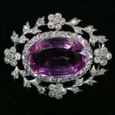 Platinum, amethyst and diamond brooch. by LiveLoveLaughMyLife