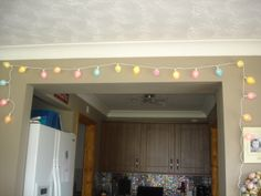 Easter Egg Fairy Lights made with a 20 set string of clear white cabled lights and Plastic Fillable eggs form £1 Shop