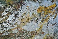 Elegant silvered oil background with golden hues.