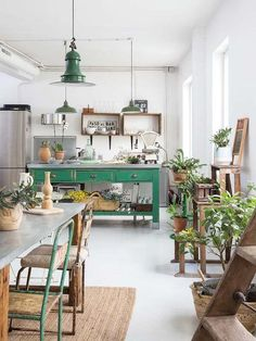 Green touches in this factory style Loft