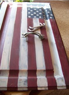 Turn an old cabinet door into a flag painted serving tray.