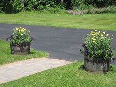 Plant your school colors in barrels at the end of the sidewalk or driveway