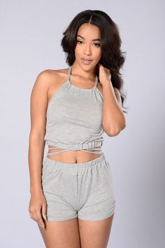 "- Pair with matching ""Not Your Babe Crop Top"" - Available in Heather Grey and Blush - Dolphin Shorts - Elastic Waistband - Made in USA - 48% Rayon 48% Polyester 4% Spandex"