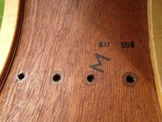 Inside stamped m for mahogany and dated may 1961