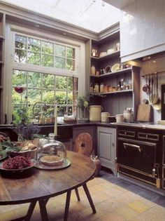 I LOVE this big window in this cozy kitchen