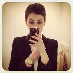 I think she looks so sexy and feminine especially with the very short hair and blazer.  Just look at those eyebrows!