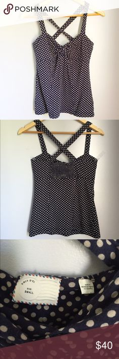 Anthropologie Navy Polka Dot Strappy Tank Anthropologie 9-H15 STCL brand sleeveless top. Navy with beige polka dots. Criss cross straps. Cute neckline and stretchy fabric in back to create the perfect fit! I'm happy to answer any questions you may have! Anthropologie Tops Tank Tops