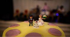 Wedding theme: Lovebirds Wedding colours: purple & yellow  On the wedding cake! A playmobil bride, groom and wedding cake (with bride and groom on the top :P)