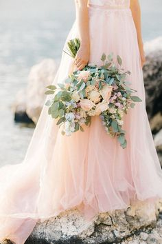 Blush bridal gown and pastel bouquet. | Floral Decorations | Flowers | Wedding Decor | #flowers #weddingdecor #weddings #floraldesigns | https://www.starlettadesigns.com/