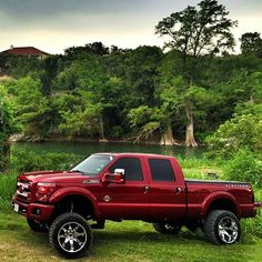 Lifted Ford F-250 power stroke diesel by lake red