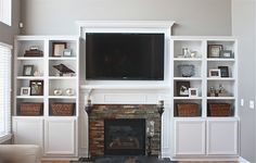 Gorgeous fireplace surround and built in bookshelves!