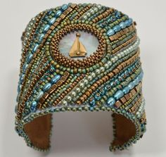 Hey, I found this really awesome Etsy listing at https://www.etsy.com/listing/218205578/bead-embroidered-wide-cuff-bracelet-sail