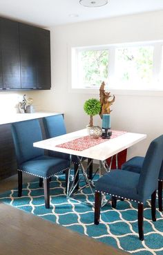 Breakfast nook in teal, blue, chrome and white. orange and wood accents. modern, contemporary, eclectic