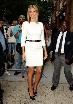 """looking glam while out and about in the Big Apple was """"Project Runway"""" hostess with the mostest, Heidi Klum, who turned heads in this belted cream dream and sky-high peep-toes. (7/19/2012)"""