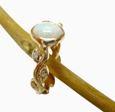 Custom Made Opal And Diamond Engagement Ring