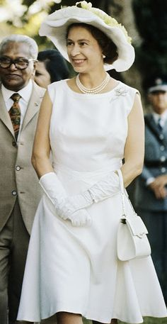 A rare glimpse of Queen Elizabeth II bare arms and another above-the-knee dress in this all-white outfit by royal couturier Norman Hartnell. Worn on tour in Mauritius in 1972.