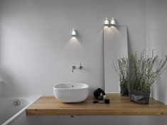A contemporary design white & glass shade bathroom wall light. LED lit for low energy usage and double insulated for use without an earth. Modern Bathroom Cabinets, Modern Bathroom Lighting, Bathroom Wall Lights, Led Wall Lights, Lamp Design, Lighting Design, Contemporary Bathroom Designs, Shower Panels, Light Fittings