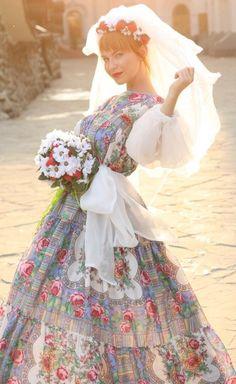 This beautiful dress is a modern twist on traditional Russian folk attire in subtle flower design!