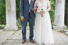 Detail of bride in blush dress with pastel bouquet and groom in navy suit with blush tie by the Bandstand at Historic Shady Lane - Historic Shady Lane Wedding Photographer