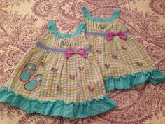 Young land Baby 24m.  Aqua and pastels seersucker sun dress with flip flop appliqué and embroidery.  $4 each