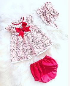 Baby Girls Red Cherry Design 3 Piece Outfit for Spring/Summer 2019. Lovely Bow Detailing with matching knickers and bonnet. Sizes 1 Month up to 3yrs. Spanish Children's Designer Clothing.   #Spring/Summer2019 #BabyGirl #girlsdresses #babygirloutfits