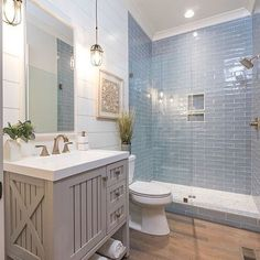 Not sure what we love more in this gorgeous bathroom the vanity shower tile or the light fixtures ? Tap the link in bio to shop beach decor & furniture ? Share your style! Beach House Bathroom, Beach Bathrooms, Master Bathroom, Beachy Bathroom Ideas, Costal Bathroom, Nautical Bathrooms, Bathroom Modern, Small Bathrooms, Basement Bathroom