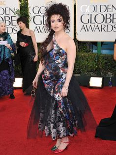 Sometimes Helena Bonham Carter hits the bullseye, and sometimes she wears these. Like a pair of mismatched Christmas bulbs, Helena sported red and green satin heels to the Golden Globes in 2011.