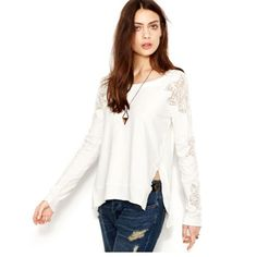 Free people pullover Off white loose pullover. Lace insets on the sleeves and shoulders. Cut out on the back. Used a few times. Free People Sweaters
