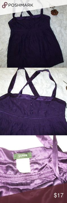 Purple 100% Silk Empire Waist Sleeveless Tank Top J. Crew Purple 100% Silk Empire Waist Sleeveless Tank Top Size 2. Item is in great shape with no holes or stains. The buttons at the front are cloth. The straps are adjustable with a button and zips up the back. See pictures for details and measurements. Check out my store for more items. Will consider all offers! J. Crew Tops Blouses