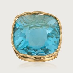 Roberto Coin Ipanema 30 Carat Blue Topaz Ring in 18-Karat Gold. A prominent blue 30 carat topaz is set in 18-karat gold. By Roberto Coin from the Ipanema Collection, this ring is reminiscent of tropical waters.