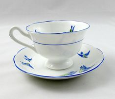 Made by Royal Albert, this tea cup and saucer are white with birds and blue trimming. Pattern is called Wild Birds Excellent condition (see photos). Markings read: Wild Birds Royal Albert Crown China England Please bear in mind that these are vintage items and there may be small