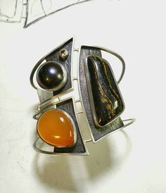 Tammy B. Jewelry | Sisters cuff. Sterling, tiger iron, brazilian agate, mabe pearl, imperial topaz.