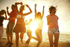 group of happy young people dancing at the beach on beautiful summer sunset by YanLev, via Shutterstock Summer Sunset, Pink Summer, Summer Loving, Summer Fun, Last Minute Reisen, How To Become Fit, Spring Break Vacations, Le Moral, Party Quotes