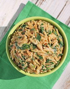 This cheesy Spinach and Parmesan Orzo is the perfect quick and easy recipe for a weeknight side dish. A great pair for grilled meats - perfect for Spring and Summer! www.emilybites.com #healthy