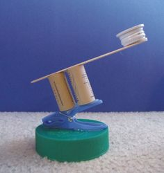 Catapult Game - bottle top glued to craft stick atop 2 corks glued to a plastic clip glued to a jar lid. Maybe use for shooting cotton balls, then measuring distances. Could also use a target. Science For Kids, Activities For Kids, Art For Kids, Catapult Craft, Cub Scout Crafts, Fun Crafts, Crafts For Kids, Holiday Club, Make A Game