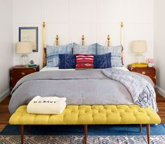 A 1950s brass Hollywood Regency headboard inspired the room's other golden accents.