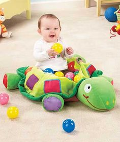 Plush Turtle Ball Pit is a portable play place filled with activities for plenty of indoor fun. Sit your baby inside the Turtle Activity Bag's soft shell and fill it with the Set of 25 Play Balls