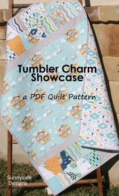 Beginner Quilt Pattern, Tumbler Charm Showcase, Charm Packs Modern Baby, Quick Simple Easy Fast, Crib Size, Focal Fabrics, Quilting Sewing by SunnysideFabrics on Etsy https://www.etsy.com/listing/223207232/beginner-quilt-pattern-tumbler-charm