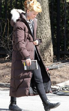 White as a ghost! Mia Wasikowska wears a Canada Goose coat on the set of Crimson Peak in T...