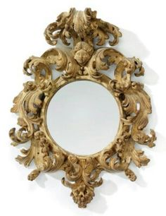 AN ITALIAN YELLOW-PAINTED MIRROR - CIRCA 1700 - The later circular plate within a pierced foliate-carved surround surmounted by a female mask and scrolled pediment, originally gilt, decoration largely rubbed 22 in.) high, 16 in. Ornate Mirror, Old Mirrors, Vintage Mirrors, Antique Frames, Mirror Mirror, Convex Mirror, Decoration Baroque, Antique Interior, Antique Furniture