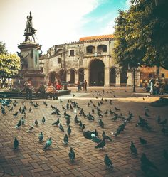 Santo Domingo, Dominican Republic | Colonial City. Statue of Cristobal Colon in front of La Catedral de Santo Domingo.