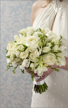 Put a very personal touch on your wedding day by creating your own bouquet. It's easy and affordable!