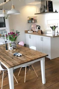 What A Lovely Coastal Bobo Kitchen For Any Family To Gather In! I Love The  Coastal Touches Of White And The Natural Tree Branch Holding Up The Light  ...