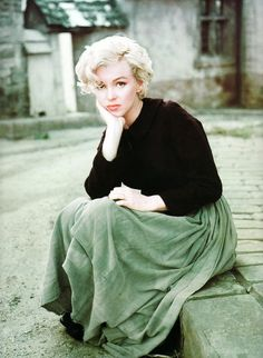 Marilyn Monroe photographed by Milton Greene, 1954. Black top and long green skirt