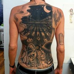 3D night view of a station tattoo on back