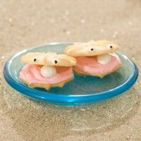 Under the Sea - Clam Cookies.  Simple to make: just two wafer cookies, pink frosting and a yogurt covered raisin in-between!