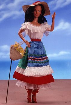 Italian Barbie looks perfectly patriotic in this delightedly colorful ensemble. Her red, white, and green skirt match the colors of her nation's flag. A blue apron with white fringe adds an extra dash of color, as do her red shoes. Rounding out this wonderful ensemble are a matching straw hat and purse.